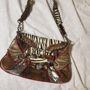 Jeweled shoulder bag.